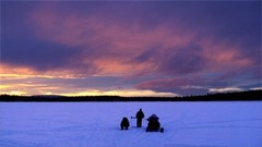 Ice fishing and snowmobiling