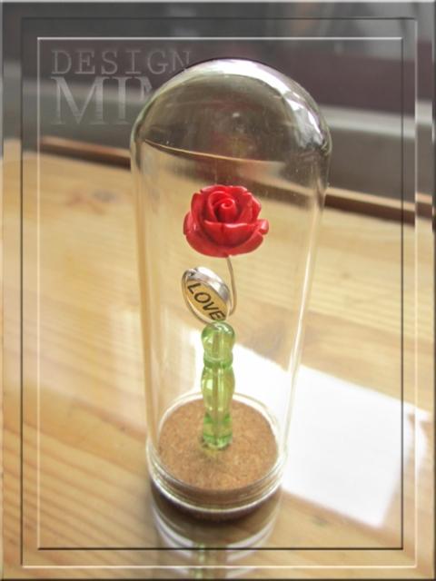 ruusu lasikupussa