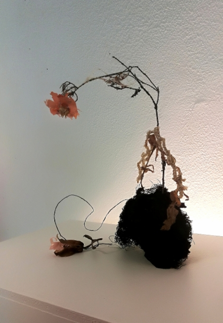 Ladyflower Plants, rootstock, partly decomposed clothes, parts from a grocery store´s plastic bag, Chanelikko / Lady Flower Art Fair 2019 on Vimeo: https://vimeo.com/353405043