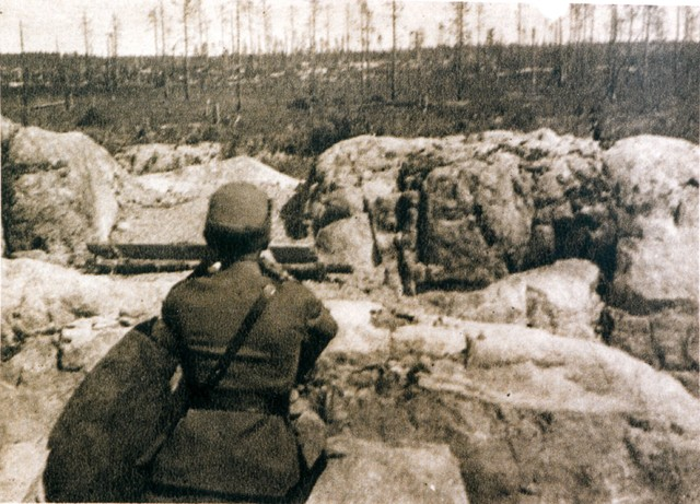 Häyhä in his own shooting spot after the war.