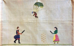 rethymnon_historic_and_foklore_museum._a_cross_stich_fabric_from_the_year_1941_showing_a_german_soldier_attacting_to_crete_where_peasants_are_ready_to_kill_him_with_knives._photo_hannu_sinisalo.
