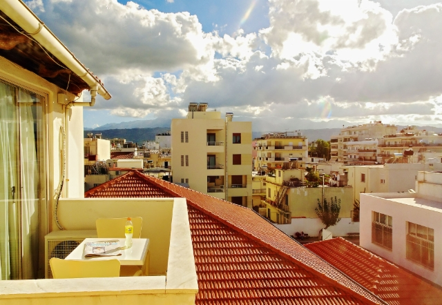 crete_chania._balcony_overlooking_the_sunny_roofs_of_chania.