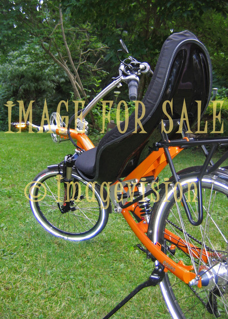 for sale orange recumbent bike on grass