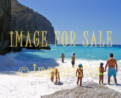 for sale people on rocky beach with surging waves