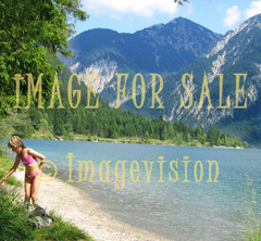 for sale beautiful mountain lake and child on beach