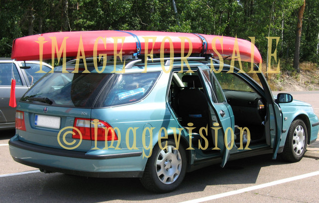for sale station wagon car with canoe on roof