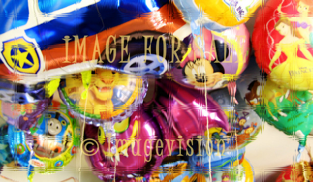 for sale colourful balloons_through glass
