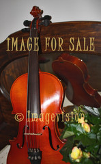 for sale violin on antique chest of drawers