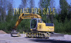 for sale yellow digger against forest
