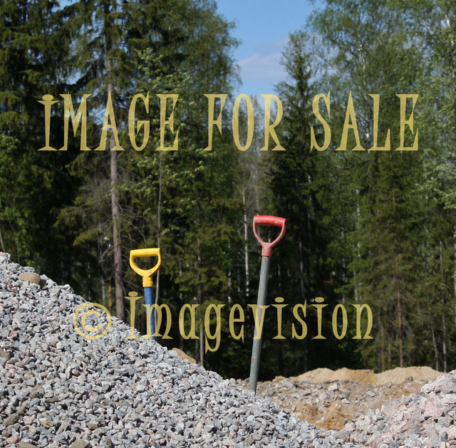 for sale two shovels and stone material