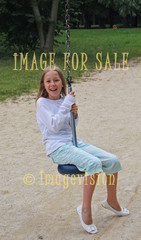 for sale girl laughing in swing