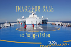 for sale passengers relaxing on helicopter deck