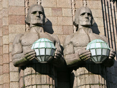 for sale serious stone men holding lamps