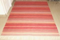 Oranssinpunainen puuvillatrikoo-räsymatto (2012)