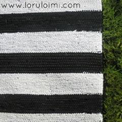 Musta-valkoinen räsymatto - yksityiskohta