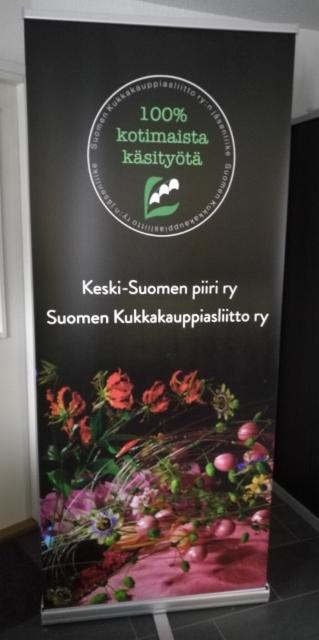 Kukkakauppiasliitto roll up -kuvateline