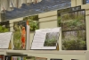 renkomaen_kirjasto_lahti._kuvanayttelyssa_kirjat_kuvien_tukena.sopii_kirjaston_teemaan.