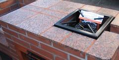 Kivipintainen pihatulisija