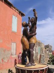 Orjakauppaa kuvaava patsas
