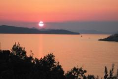 B68 Aurinko laskee saaristossa