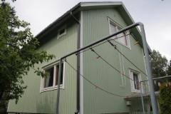 Värin vaihdolla ummehtuneen värisestä talosta saatin kaunis ja edustava rintamamiestalo