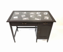 Pöytä kuvilla