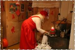 Mrs Santa is baking ginger biscuits