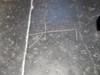 masku puumerkki lattialaatassa