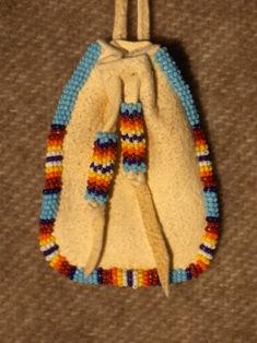 amulettikukkaro turkoosi-tulivarit