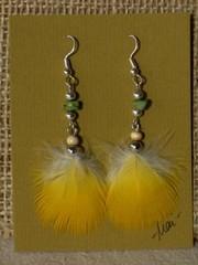unituulia hoyhenkorvikset keltainen-vihrea