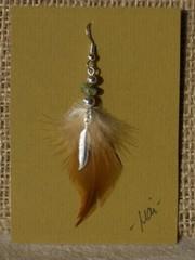 unituulia hoyhenkorvis ruskea-vihrea-hopea